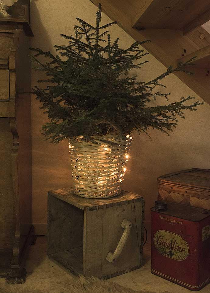 Ljusslinga i julgransfoten av Helen Thalen