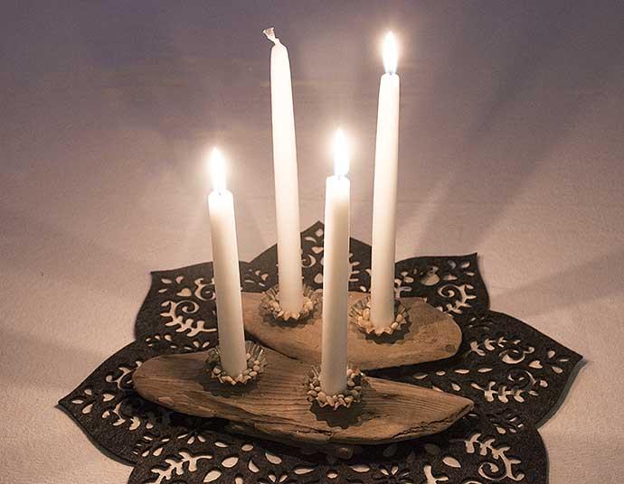 Candlestick of driftwood by Helen Thalen